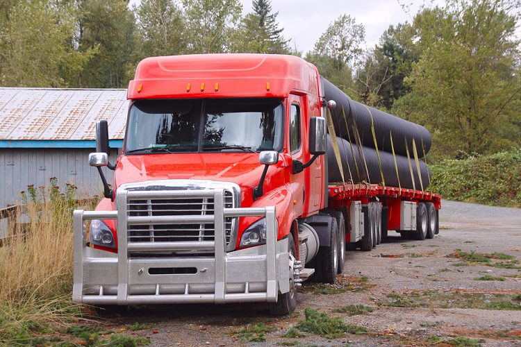 Is Flatbed Trucking or Driving Hard and How Difficult Is Tarping Loads?